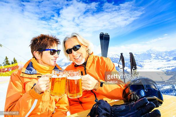 skiing senior couple having a break