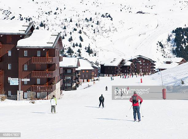 skiing through mottaret - meribel stock photos and pictures