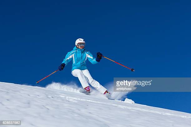 skiing woman on skis in powder snow