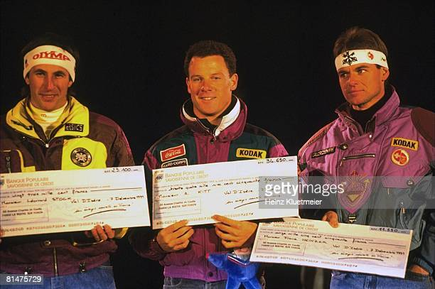 Skiing World Cup Closeup of AUT Leonard Stock USA AJ Kitt and CHE Franz Heinzer victorious with prize check after winning event Val d'Isere FRA...