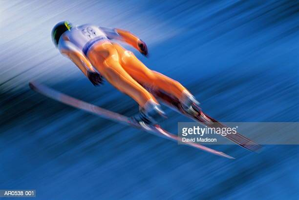 ski-jumping (blurred motion) - ski jumping stock pictures, royalty-free photos & images