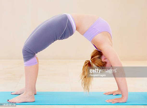 skilled at her technique - pilates - beautiful women bent over stock photos and pictures