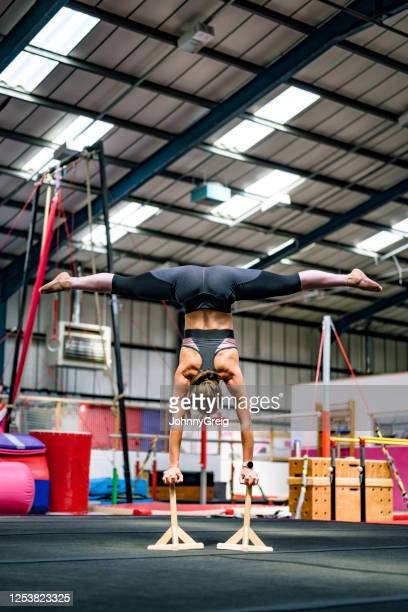 skilled female athlete balancing on handstand canes - legs apart stock pictures, royalty-free photos & images
