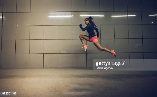 skilled girl - long jump stock pictures, royalty-free photos & images