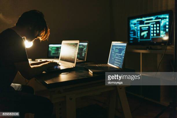skilled hacker stealing and committing crime - threats stock pictures, royalty-free photos & images