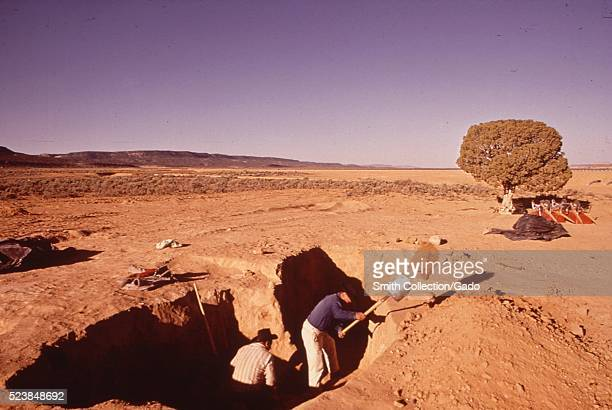Skilled Navajos carry out archaeological excavations. The dig was a project of the Museum of Northern Arizona. Image courtesy National Archives,...