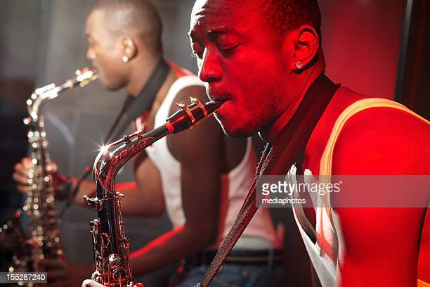 skilled saxophonist - blues music stock pictures, royalty-free photos & images
