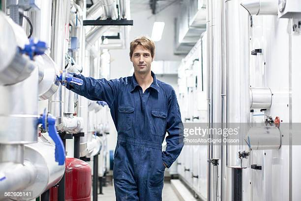skilled worker in industrial plant, portrait - incinerator stock photos and pictures