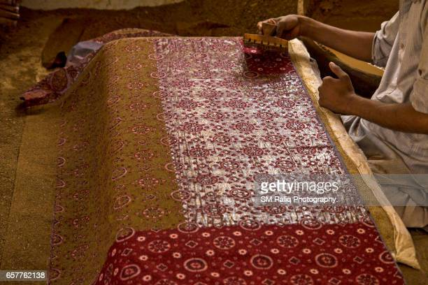 Skilled workers are busy producing Ajrak shawls