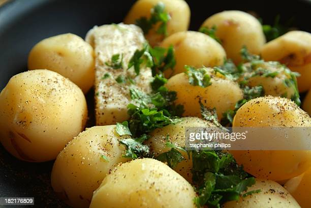 Skillet Full of New Potatoes with Parsley and Butter