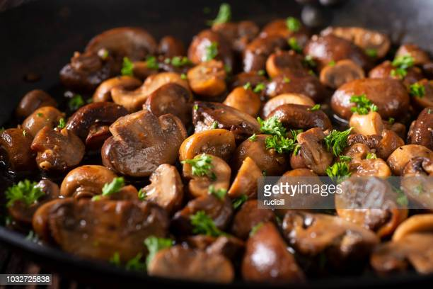 skillet mushrooms - edible mushroom stock pictures, royalty-free photos & images