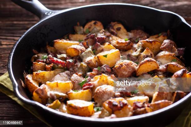 skillet roasted potatoes - root vegetable stock pictures, royalty-free photos & images
