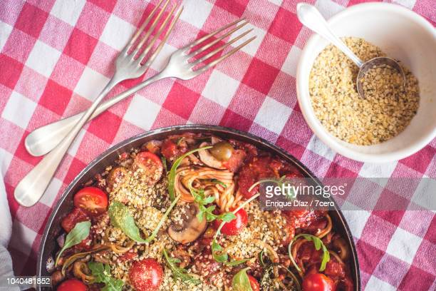 Skillet Spaghetti on Gingham Tablecloth with Forks