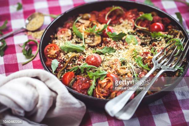 Skillet Spaghetti with Rucula and Hemp Parmesan Toppings and Forks