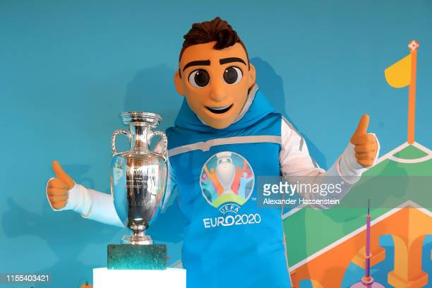 Skillzy the official mascot of the UEFA EURO 2020 poses with the EURO Championships Winner trophy at the EUROCountdown 2020 One Year to go kickoff...