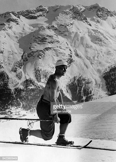 Skiläufer mit nacktem Oberkörper inDavoserschienen Quer 2/1932Foto Riebicke