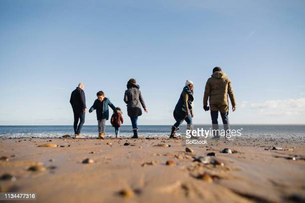 skimming stones into the sea - whitley bay stock pictures, royalty-free photos & images