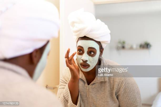 skin care at home during covid-19 pandemic - indulgence stock pictures, royalty-free photos & images