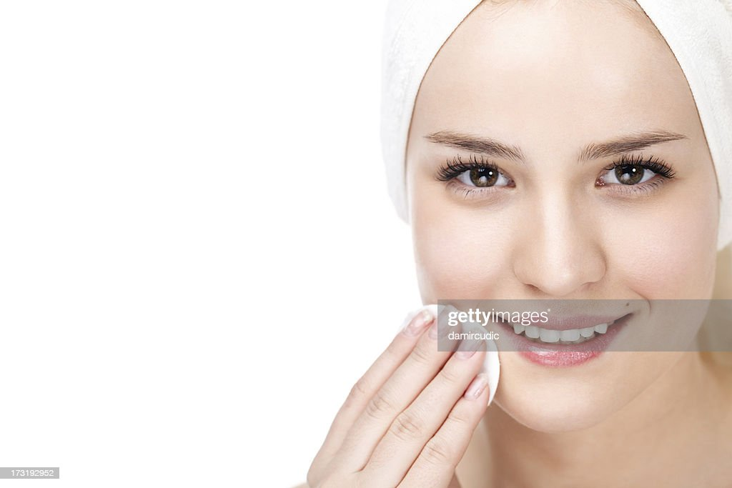 Skin care woman removing makeup : Stock Photo