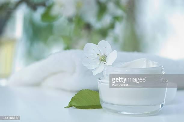 Skin cream with cherry blossom, bath towel