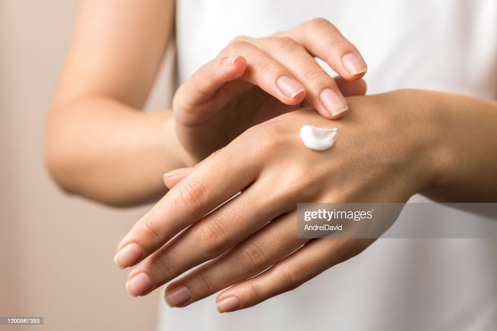 skincare. close up view of woman hand moisturising them with cream. skincare : Stock Photo