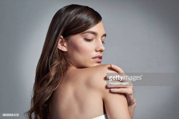 skincare is important to her - shoulder stock pictures, royalty-free photos & images