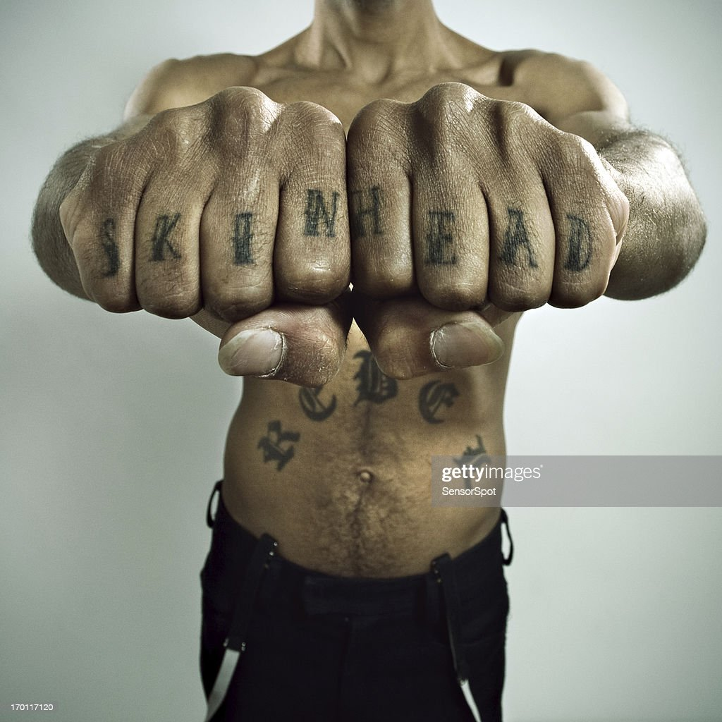 Skinhead Showing off Knuckle tattoo : Stock Photo