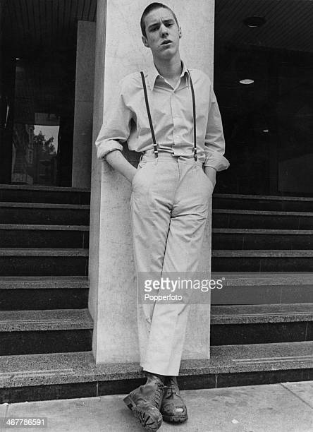 A skinhead wearing slacks held up by braces and worn short to show off the boots 26th September 1969