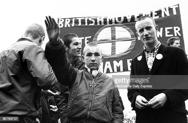 Skinhead with a sticker on his forehead �Stop this Multiracial Madness� The British Movement banner behind advocates �White Power�