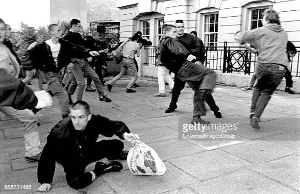 Skinheads fighting with AntiNazis at Waterloo station during a picket to stop a rendezvous for a skinhead gig London 12/9/1992