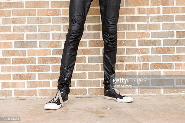skinny legs in wet jeans - skinny jeans stock pictures, royalty-free photos & images