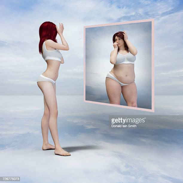 skinny woman viewing overweight reflection in floating mirror - anorexia nervosa imagens e fotografias de stock