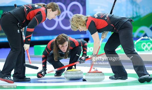 Skip Cheryl Bernard keeps a close eye on a rock as it comes into the house with sweepers Susan O'Connor and Carolyn Darbyshire Canada loses to Sweden...