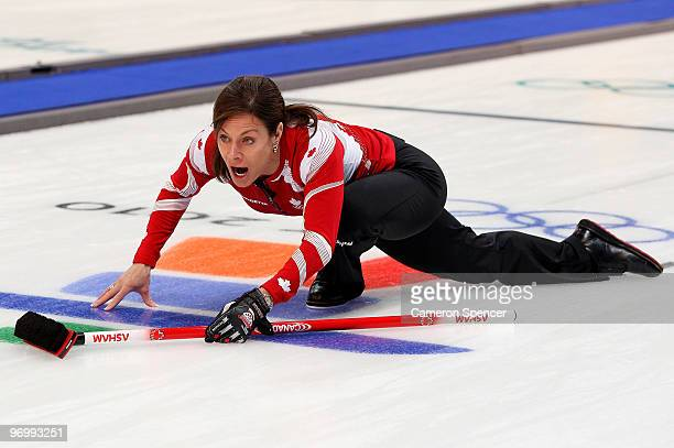 Skip Cheryl Bernard of Canada watches her stone slide down the sheet during the women's curling round robin game between Canada and Great Britain on...