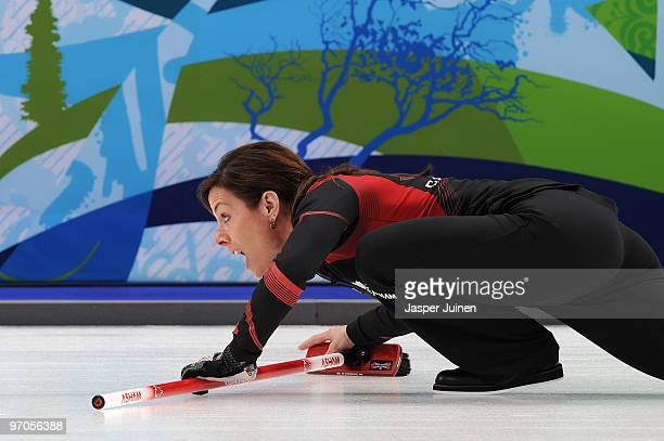 Skip Cheryl Bernard Of Switzerland follows the stone during the women's curling semifinal game between Canada and Switzerland on day 14 of the...