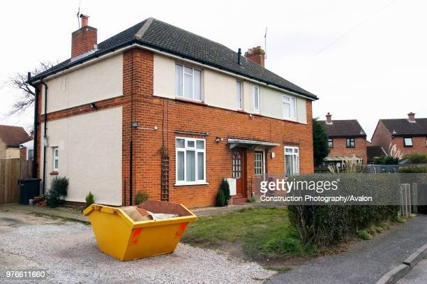 Skip in front of a house under refurbishment