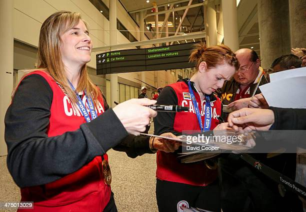 Skip Jennifer Jones and lead Dawn McEwen sign autographs for fans of the Canadian Women's gold medal curling Team just after getting of the plane in...