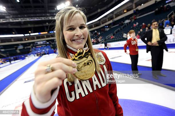 Skip Jennifer Jones holds up her medal after winning the Women's Final against Team Middaugh at the Roar of the Rings Canadian Olympic Curling Trials...