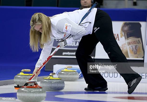 Skip Jennifer Jones sweeps after great shot by Second Jill Officer not shown during the Women's Final against Team Middaugh at the Roar of the Rings...