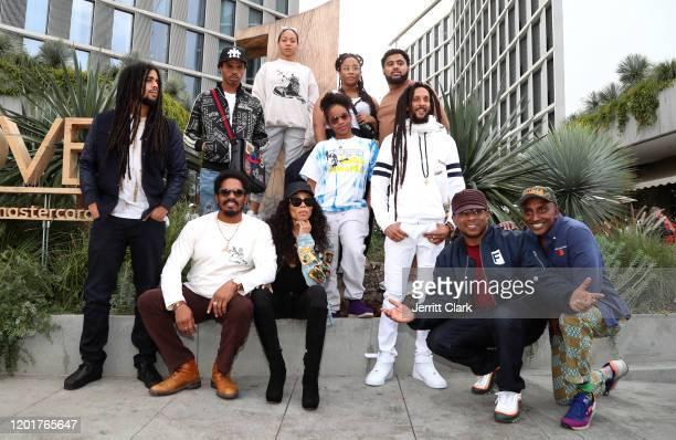 Skip, Joshua, Mystic, Zuri, Nico, Rohan, Cedella, Shacia and Julian Marley pose with Sway Calloway and Marcus Samuelsson outside Primary Wave x...