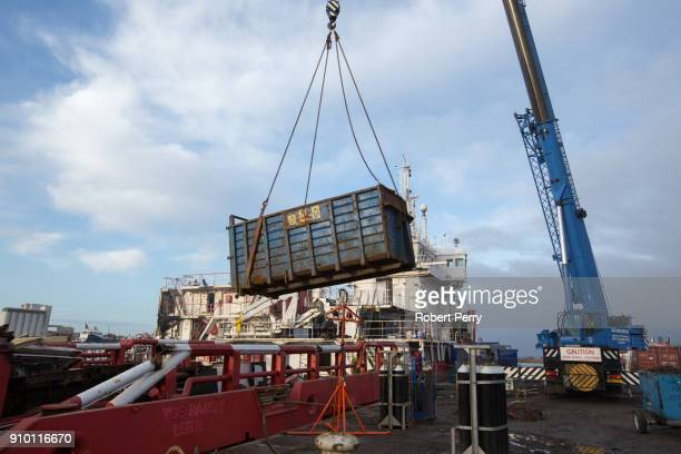 A skip of scrap is lifted off the deck of the decommissioned ship Lismore in Leith's Imperial Dry Dock on January 25 2018 in Leith Scotland The...