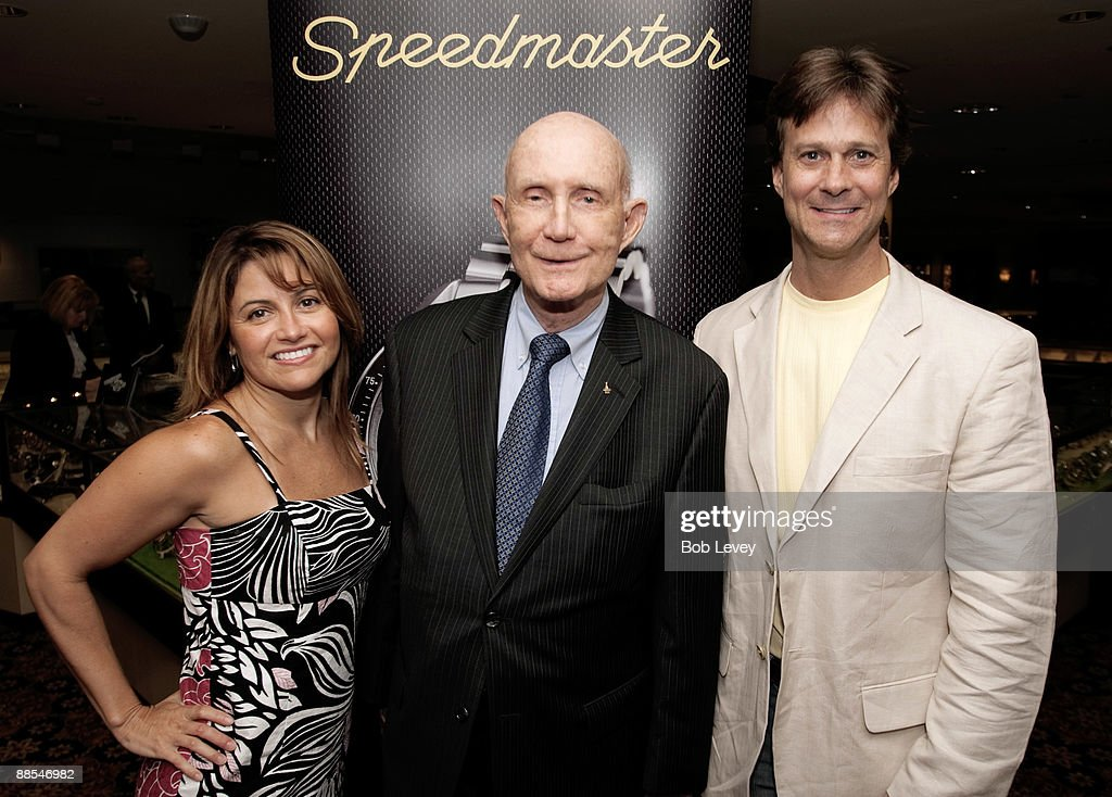 Skip & Sela Burrows pose with General Thomas Stafford as the attend a cocktail reception hosted by Omega at the I.W. Marks Jewelers on June 17, 2009 in Houston, Texas.