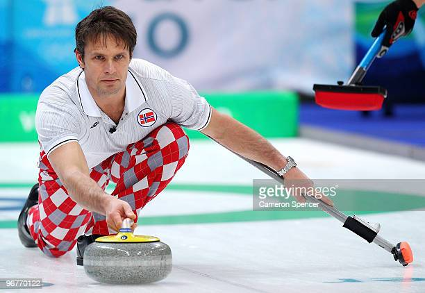 Skip Thomas Ulsrud of Norway releases his stone down the sheet during the men's curling round robin game between Norway and the United States on day...