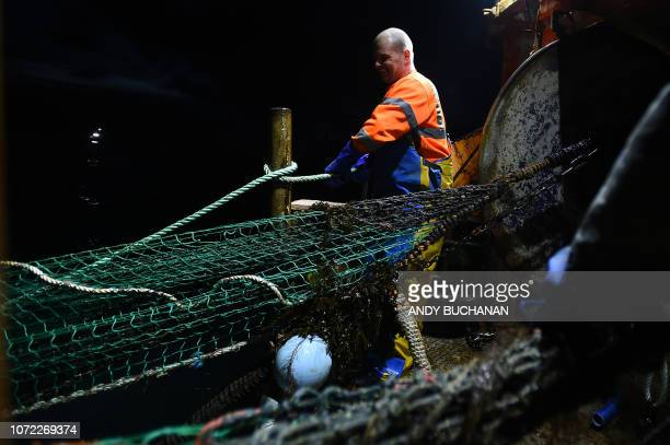 Skipper Andy Brown works fishing for prawns on the fishing trawler 'Scotia Star' in the North Sea off the east coast of Scotland on December 10 2018...