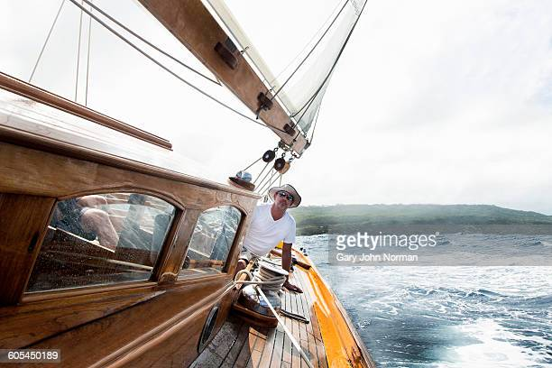 Skipper at helm of classic yacht