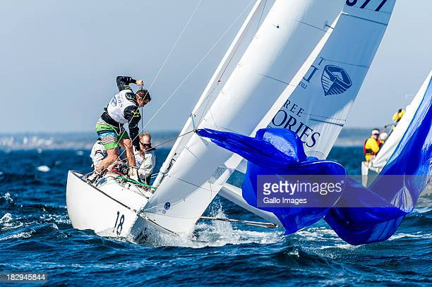 Skipper Brad Julian rounds the top mark and the crew hoists the spinnaker in the second race of the J/22 World Championship regatta on October 2...