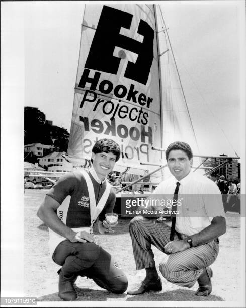 Skipper Craig Ramsden with Rugby Union player Mark Ella who launched the new Hooker Project 18 footer at Steyne Park, Double Bay. October 22, 1985. .