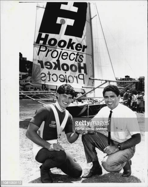 Skipper Craig Ramsden with Rugby Union player Mark Ella who launched the new Hooker projects 18 footer at Steyne Park, Double Bay. October 22, 1985. .