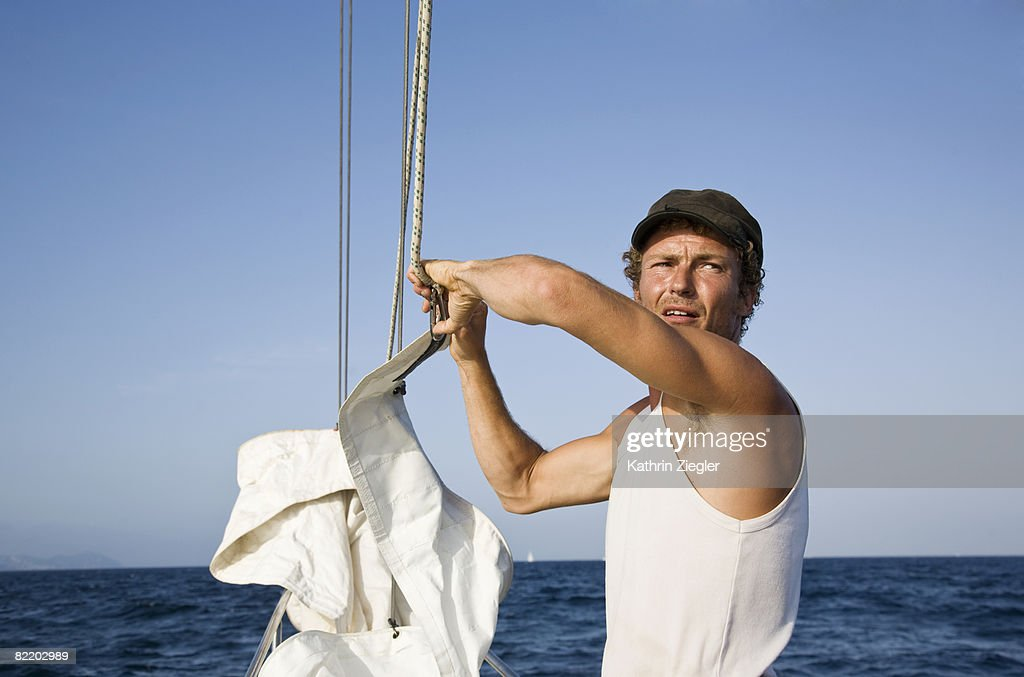 skipper getting sailing boat ready : Stock Photo