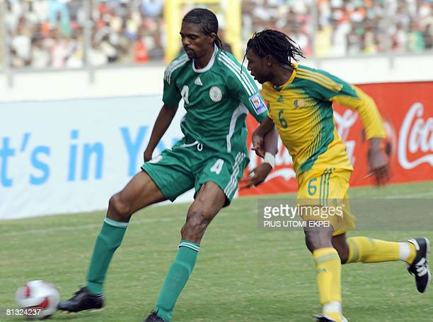 Skipper of the Nigerian team Kanu Nwankwo tries to beat South African Macbeth Sibaya during FIFA 2010 World Cup and Africa Cup of Nations qualifying...